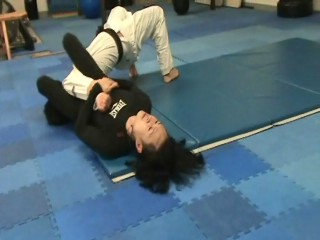 Headlock escape from the ground by cradle under method